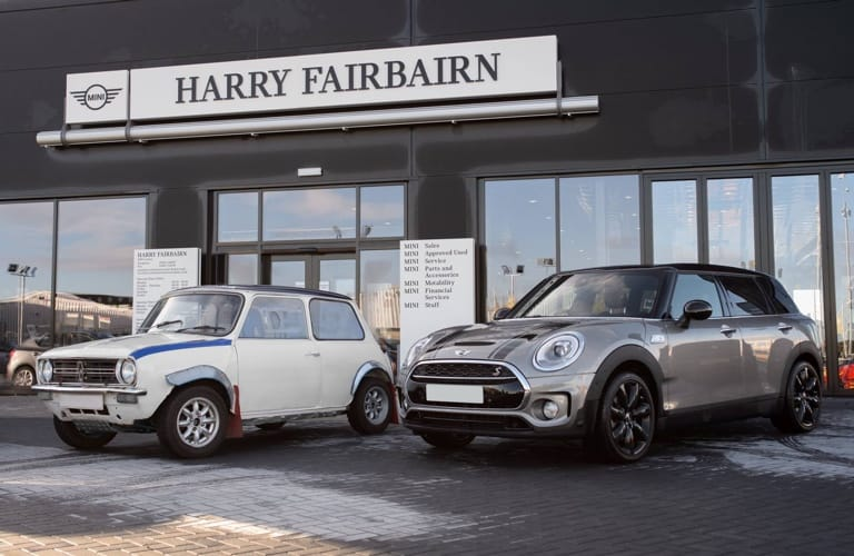 Old and new MINI's outside Harry Fairbairn branch.