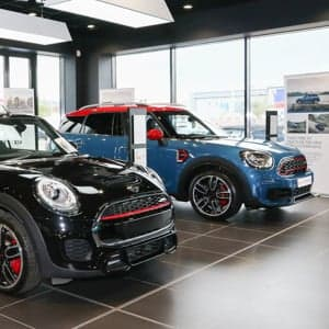 Front view of two MINIs in a showroom.
