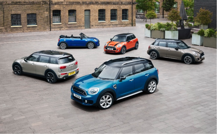 Range of MINI models parked in a courtyard